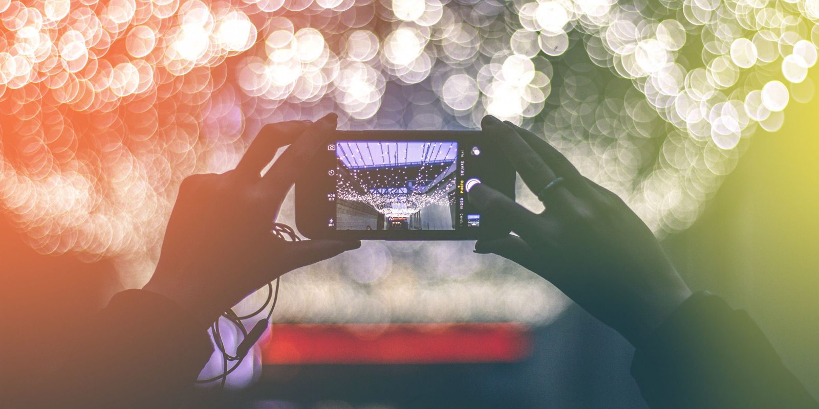 woman-photographing-city-lights-at-night-with-mobile-phone_s